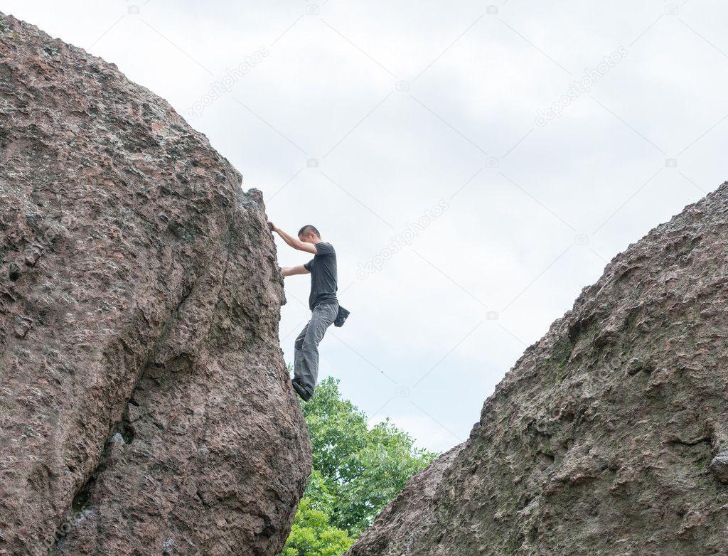 Man climbing on a limestone wall