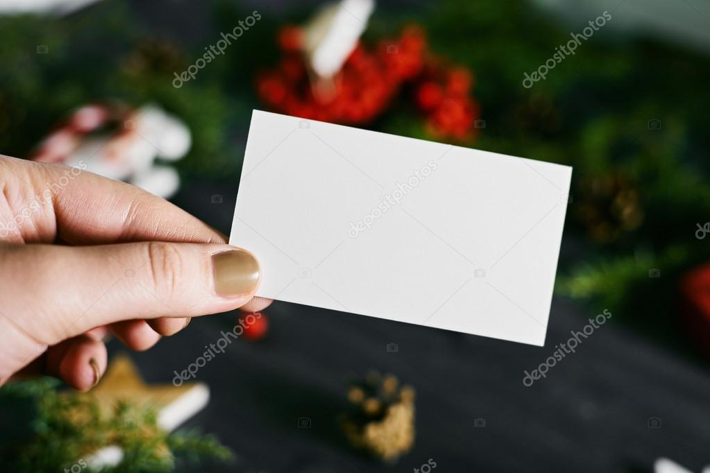 Blank business card in hand on a New Years background — Stock Photo ...