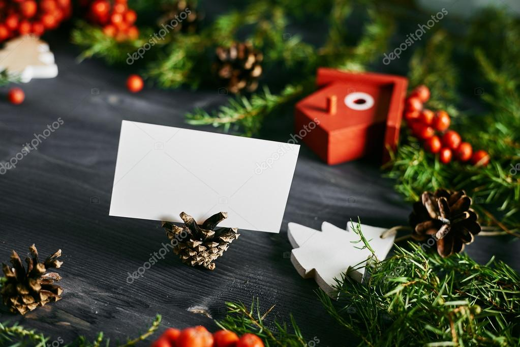 Blank business card on a christmas wooden background stock photo blank business card on a christmas wooden background white business card for designers photo by olegsamoylov reheart Images