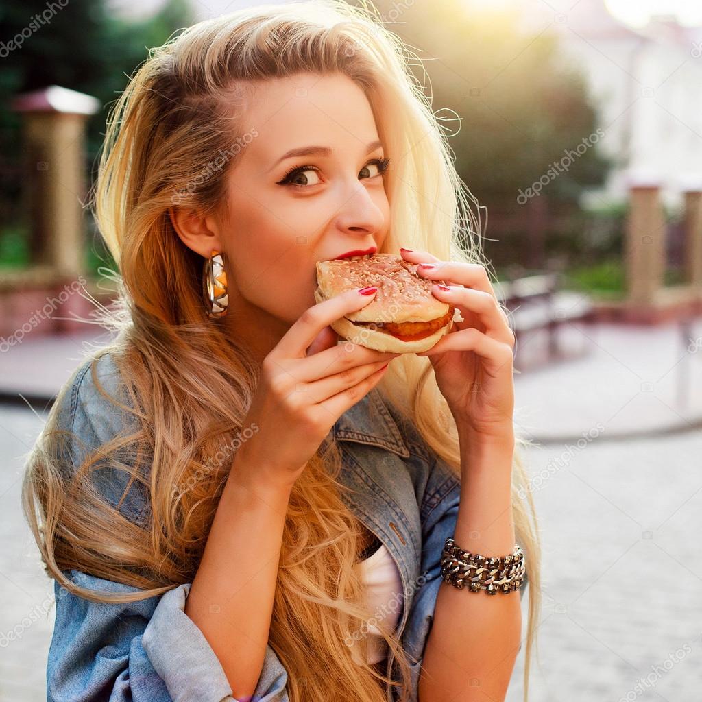 funny woman eating hamburger stock photo solominviktor 96850214