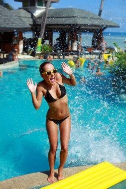 woman having fun near the pool