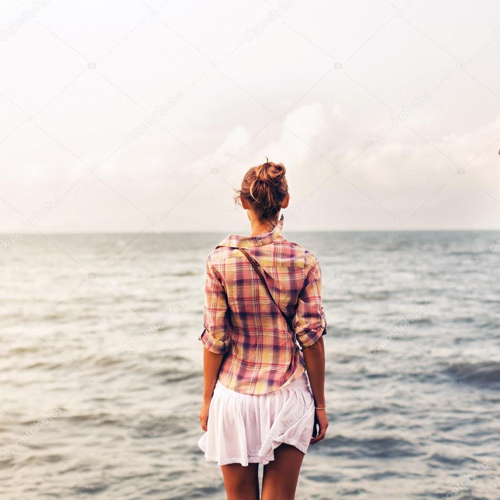 woman posing near the sea