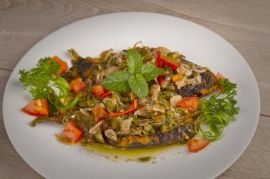 Grilled fish with pickled chili