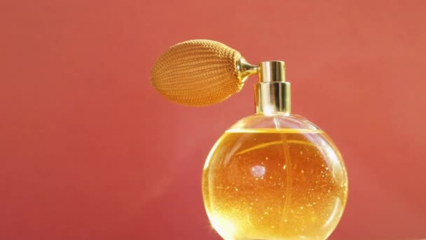 Golden perfume bottle and shining light flares, chic fragrance scent as luxury product for cosmetic and beauty brand
