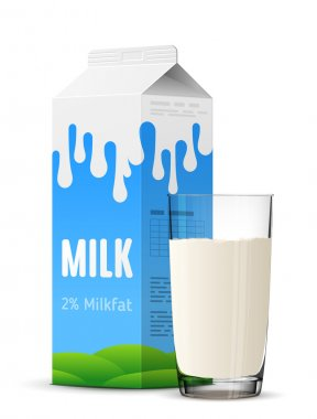 Glass of milk with gable top package close up