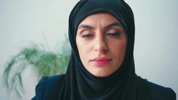 Portrait of muslim businesswoman looking at camera in office