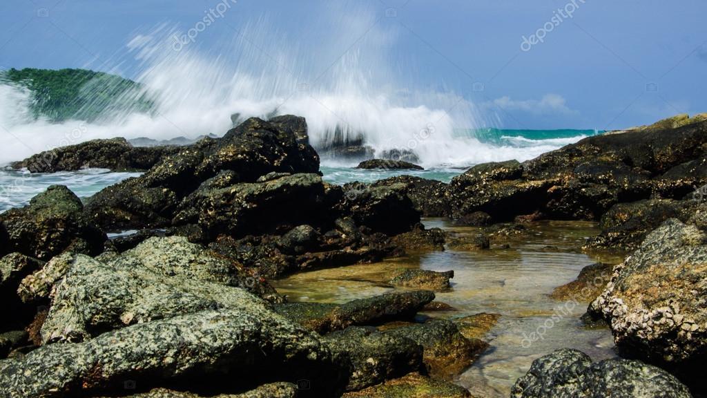Massive Waves Crashing On Rocks