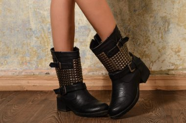 autumn black women's boots in the straps and rivets