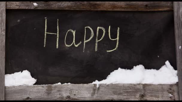 Grunge-Kreide-Inschrift auf das Brett frohes neues Jahr. Timelapse