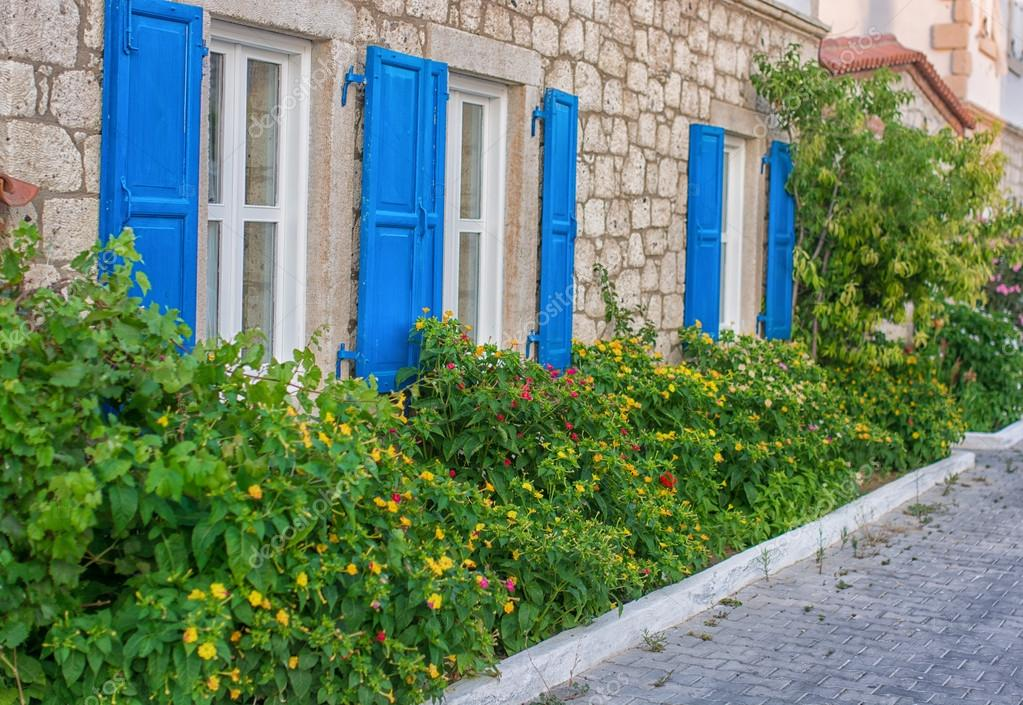 Typical greek traditional village with  colorful doors, windows on Greece
