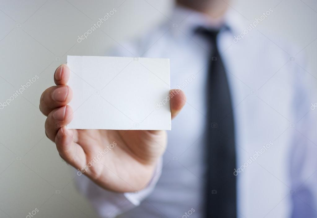 Mans hand showing blank card