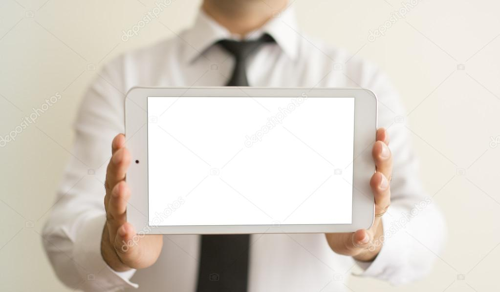 man hands holding a white tablet or blank page