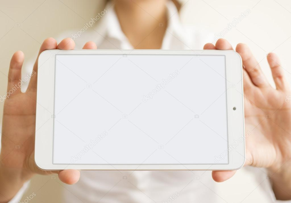 woman hands holding a white tablet or blank page