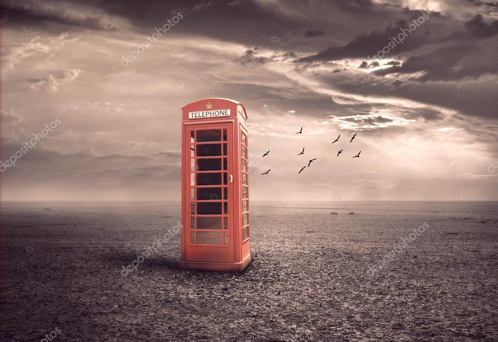 traditional red telephone booth or public payphone