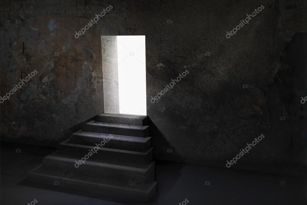 Open door and upstairs in a dark room with light outside Stock