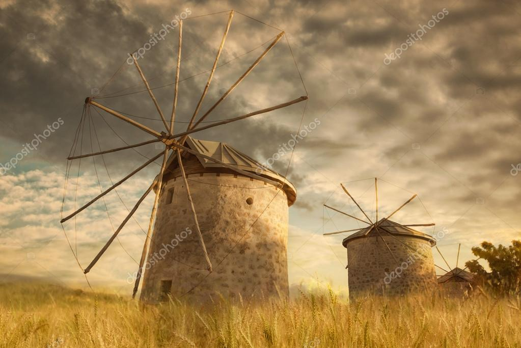Old mill on the yellow wheat field