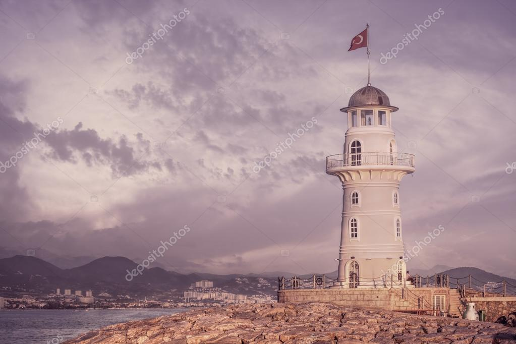 Beautiful nature landscape with mountains range, cloudy sky and lighthouse in port Alanya, Turkey
