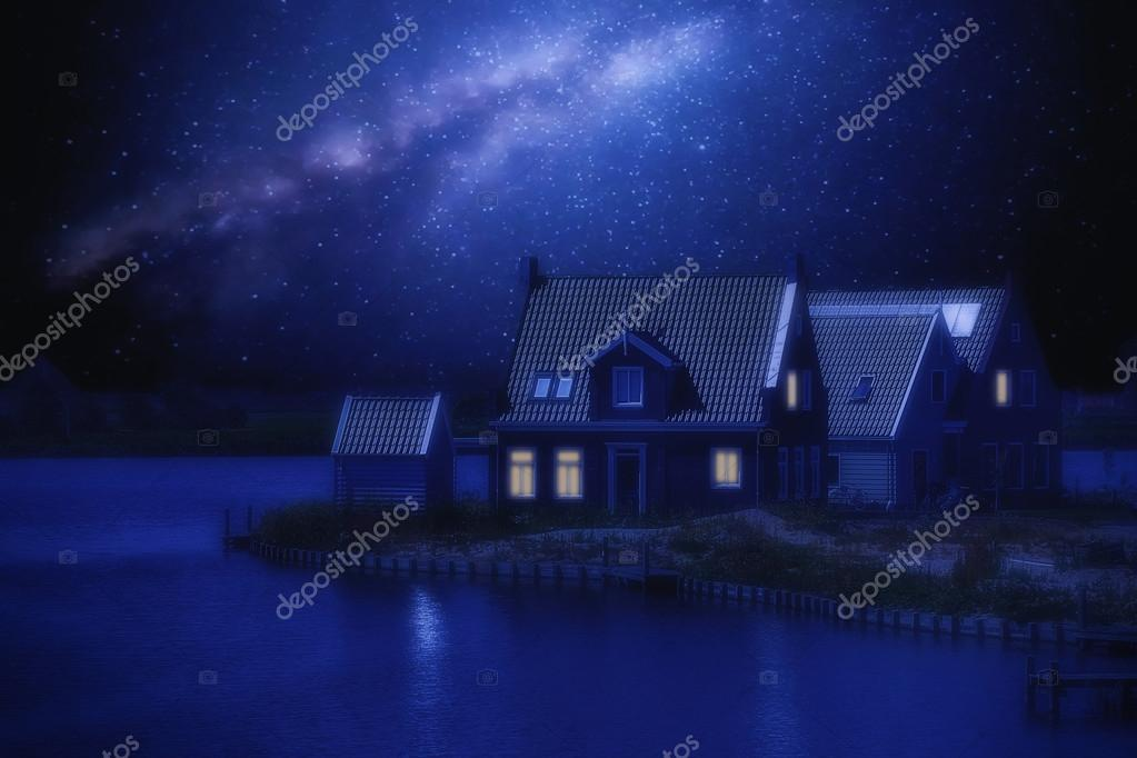 wooden house on a background of the night sky