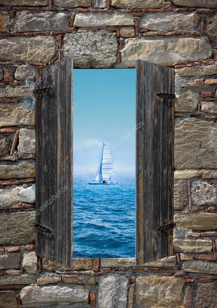 View of a sailing boat threw a window