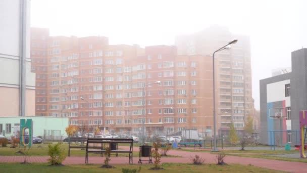 multi-storey city buildings in fog