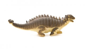 brown Pinacosaurus toy on a white background