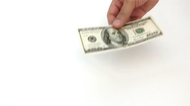 Zählen usd Papierwährung auf weiß