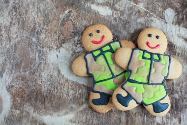 Two homemade Gingerbread men in protective khaki uniforms on Def