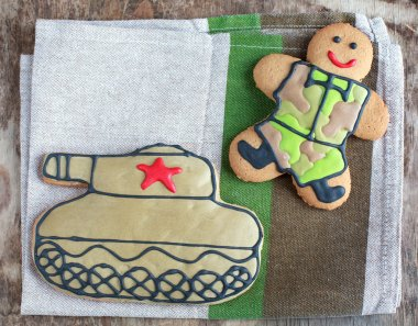 Homemade Gingerbread man in protective khaki uniforms and the ta