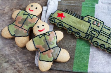 Homemade gingerbread old Soviet locomotive and soldiers in prote