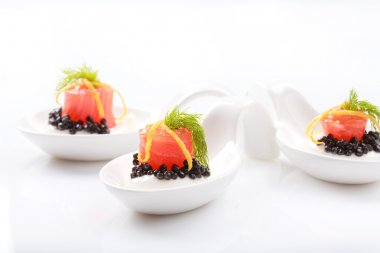 Appetizers in portion spoons of cream cheese, natural sturgeon b