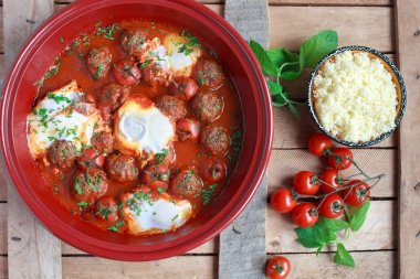 Moroccan tagine of lamb with kefta (meatballs), tomatoes and egg