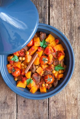 Moroccan Tagine with beef, chickpeas,  pumpkin and cherry tomato