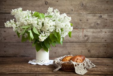 Still life. Bouquet of white lilacs in a vase