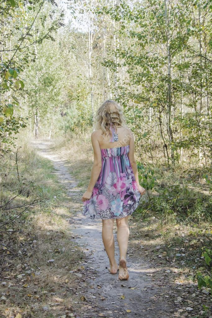 Barefoot Woman Walking Through The Forest Stock Photo