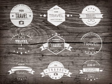 Realistic highly detalized wood background with travel labels. Old wooden plank.