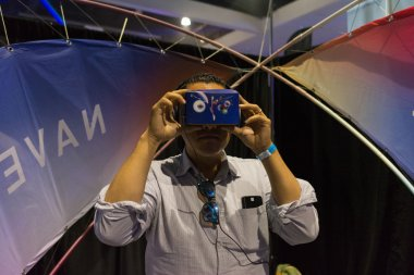 Man wearing virtual reality goggles during VRLA Expo Summer