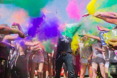Norwalk, California, USA - March 7, People celebrating during the color throw at the Holi Festival of Colors stock vector