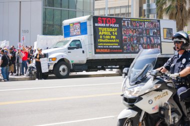 Truck with banner parked in front of police department