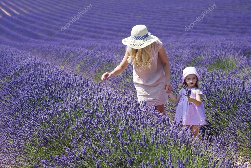 Mother with daughter in lavender field
