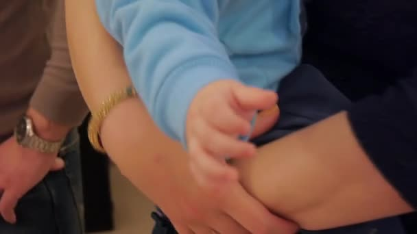 Baby on hands at mum