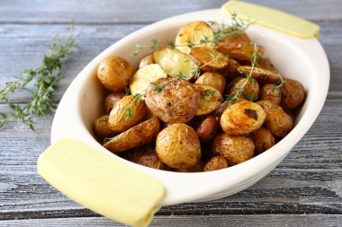 Baked potatoes in a bowl