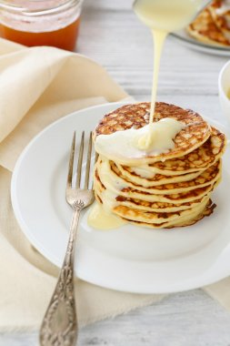 Stack of pancakes with condensed milk