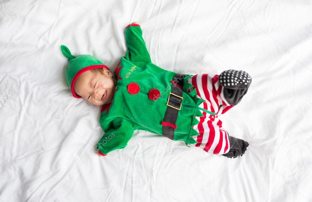 8581dd98774ae Baby in green elf costume for christmas holiday on white background — Image  de ...