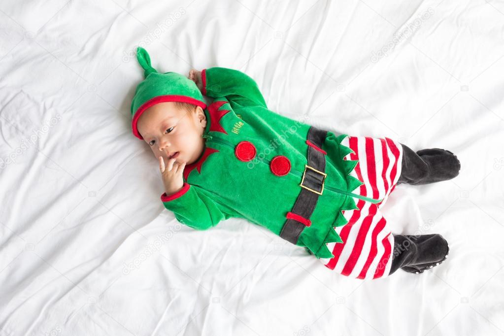 allacciarsi dentro Prezzo del 50% qualità stabile Bambino in costume da elfo per vacanze di Natale su priorità ...