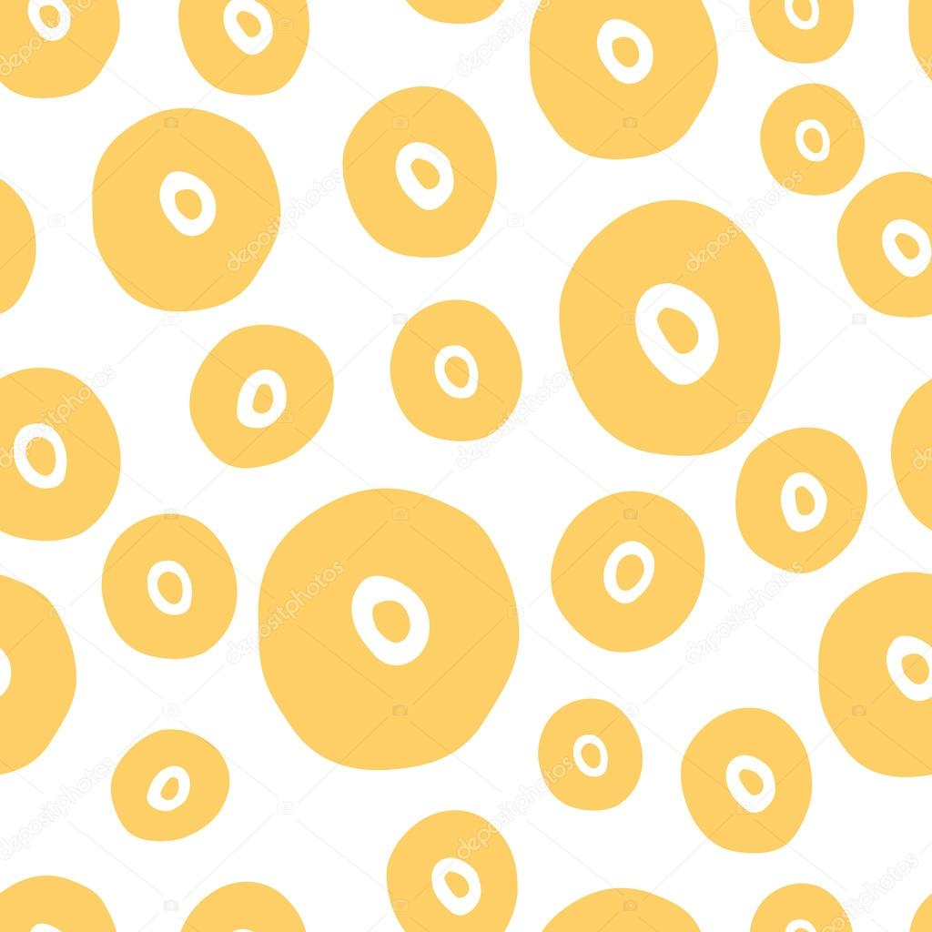 Seamless dot pattern. Hand painted circles with rough edges in yellow color.