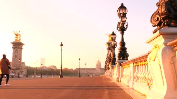 Paris, France. October 18. 2020. Historical monument. Bridge Alexandre 3 at sunrise. Located in the tourist district of Les Invalides. Tourist woman walking.