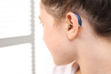 child with a hearing aid.