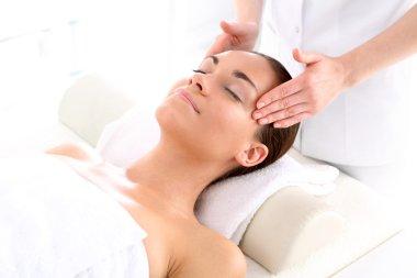 Beauty salon, the woman at face massage