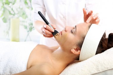 Makeup artist applied foundation