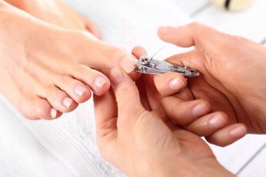 Nail clipping, cutting skins pedicure treatment